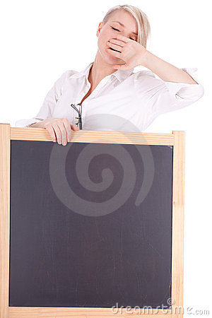 Yawning young lady teacher with blackboard
