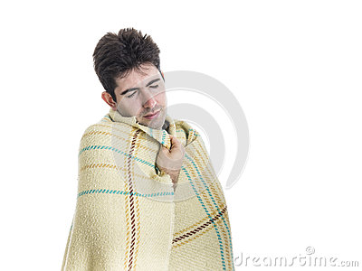 Yawning young man with wrapped plaid