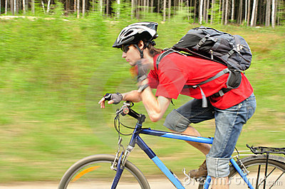 Сyclist tightening helmet