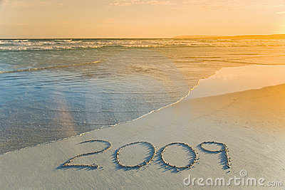 Year 2009 written on beach