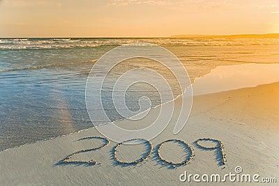 Year 2009 written on beach