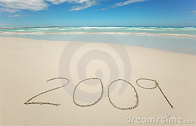 Year 2009 written on tropical beach