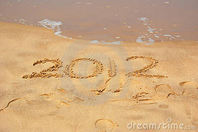 Year 2012 written in sand