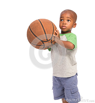 Year old baby boy standing holding a basket ball stock photo image