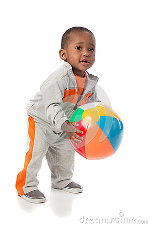 Year old baby boy standing holding a beach ball stock photo image