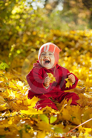 Year-old baby girl  in autumn park