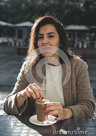 Rapid Plans For Date Women Online year old woman drinking coffee terrace backlit bar 83796613