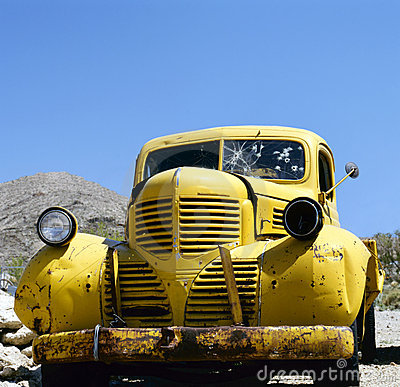 An yellow abandoned Bonnie and Clyde vehicle