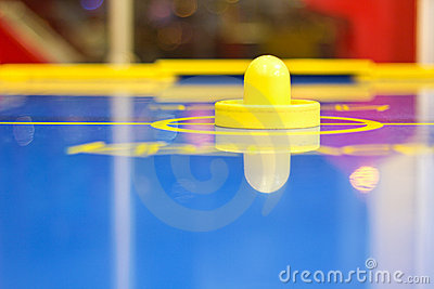 Yellow air hockey mallet