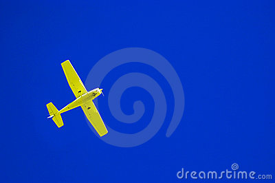 Yellow airplane and blue sky