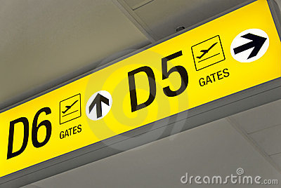 Yellow airport direction departure sign