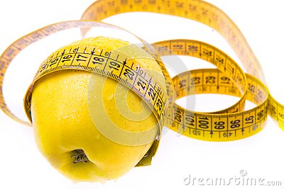 Yellow apple and ruler. Healthy lifestyle.