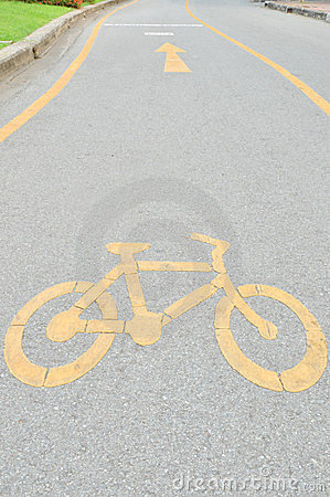 Yellow arrows and bicycle sign path