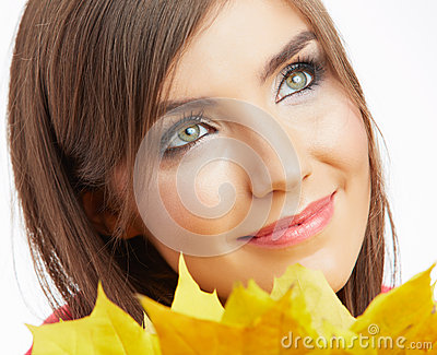 Yellow autumn leaves, close up woman face