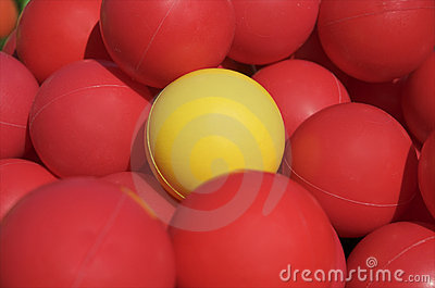 Yellow ball among red balls