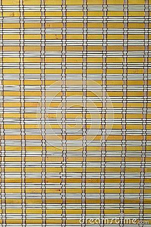 A  yellow bamboo mat texture.