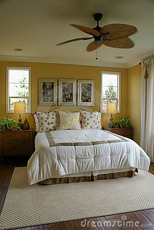 Yellow Bed Room with Fan