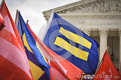 Yellow Blue Flag And Red Pink Flag Near White Building During Day Time Free Public Domain Cc0 Image