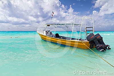 Yellow boat on the coast of Caribbean Sea