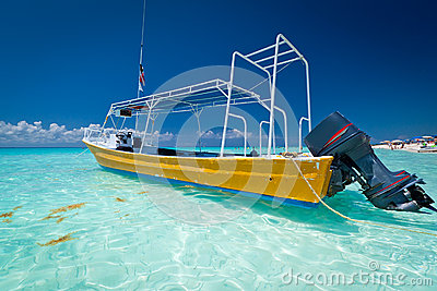 Yellow boat on the coast of Caribbean Sea