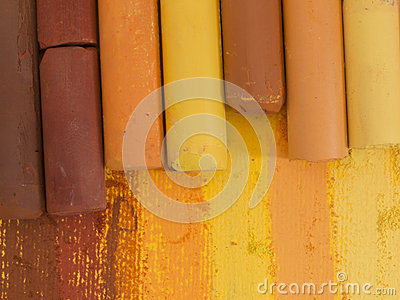 Yellow and brown artistic crayons