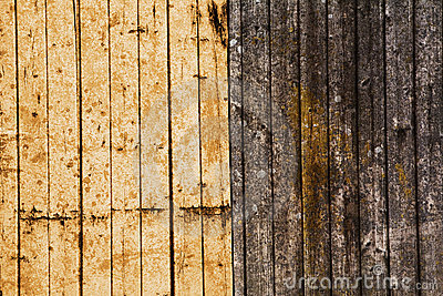 Yellow and brown wood texture w. weathered planks