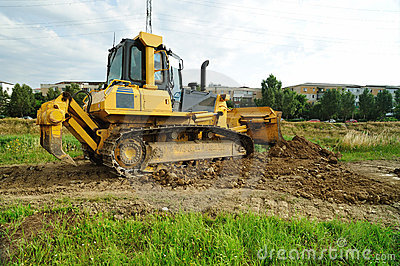 Yellow bulldozer working