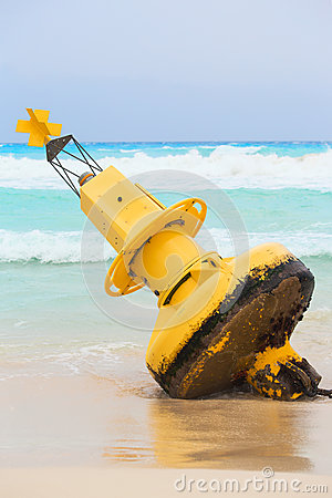 Yellow buoy on mexican beach Stock Photo
