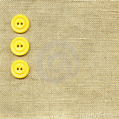 Yellow buttons on beige fabric