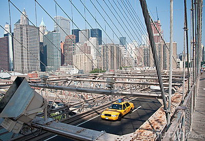 Yellow cab on Brooklyn bridge Editorial Photography