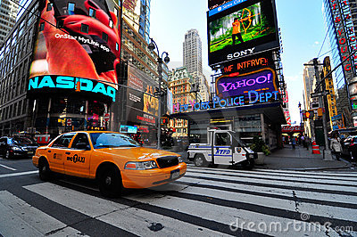 Yellow cab passing through times square Editorial Stock Photo