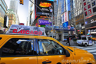 Yellow cab passing through times square Editorial Image