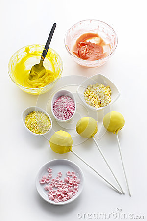 Yellow cake pops  on white background
