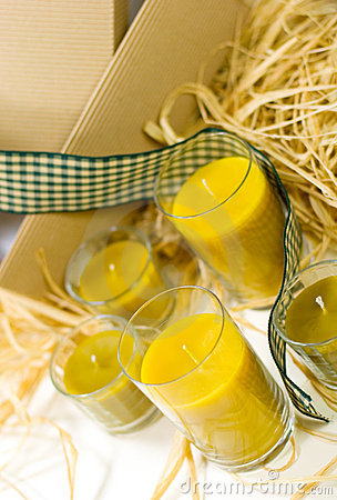 Yellow candles, ribbon and box