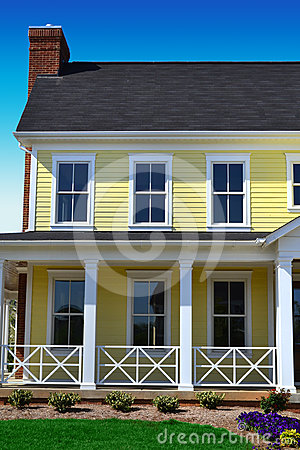 Yellow Cape Cod Home in the Springtime