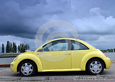 Yellow family car on road