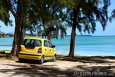 Yellow car on tropical beach