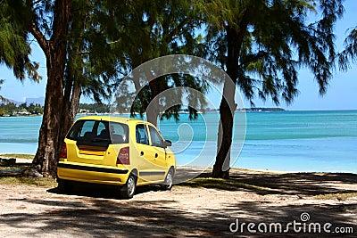 Yellow car on tropical beach