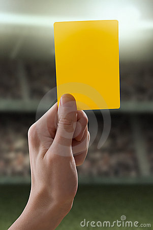 Yellow card with hand from referee giving a penalt