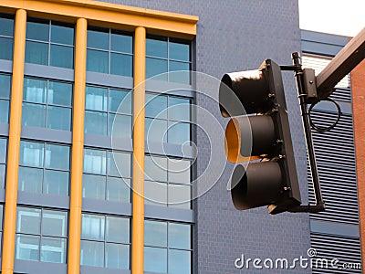Yellow caution traffic signal light
