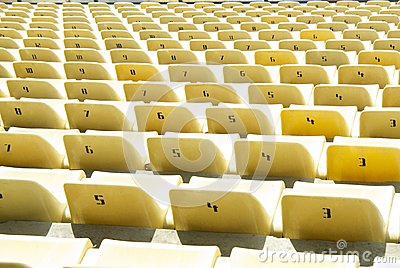Yellow chairs on a soccer stadium