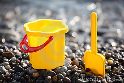 Yellow children s bucket with scoop on seacoast