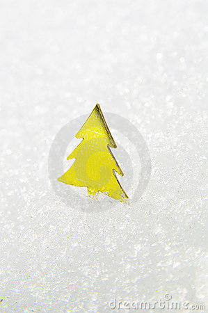 Yellow Christmas tree on snow