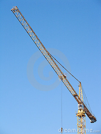 Yellow construction hoisting crane on clear sky