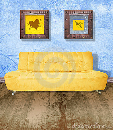 Yellow couch on grunge blue