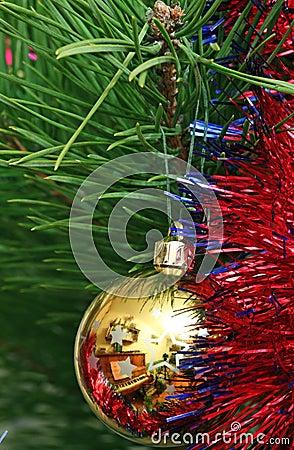 Yellow Cristmas ball on the Cristmas tree