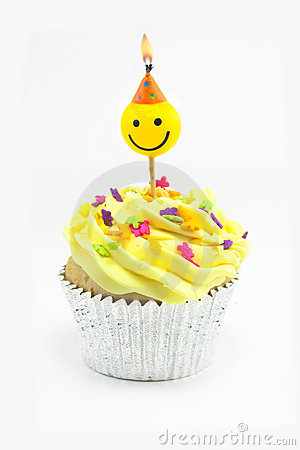 Free Yellow Cupcake And Smiley Candle Royalty Free Stock Photo - 11690945