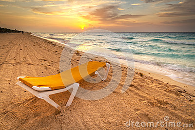Yellow deckchair at Caribbean sunrise