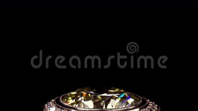 Yellow diamond ring no 3D, it`s video shooting only. Real dispersion, yellow diamonds, extreme close up stock video