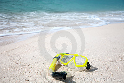 Yellow diving mask on the beach